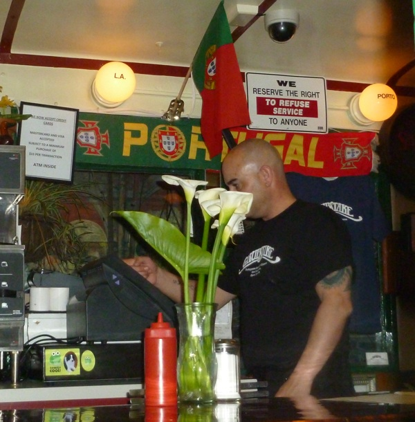 Picture of cashier and Portugal soccer banner at Grubstake in SF